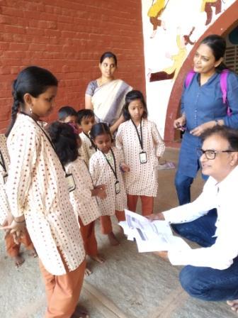 Mr Seolekar with kids at Isha Vidhya